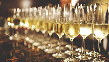 champagne glasses on granite counter top
